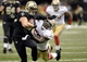 Nov 17, 2013; New Orleans, LA, USA; New Orleans Saints tight end Jimmy Graham (80) carries up the field against San Francisco 49ers inside linebacker Patrick Willis (52)  during the fourth quarter at the Mercedes-Benz Superdome. Mandatory Credit: John David Mercer-USA TODAY Sports