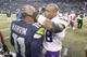 Nov 17, 2013; Seattle, WA, USA; Minnesota Vikings running back Adrian Peterson (28) greets Seattle Seahawks wide receiver Percy Harvin (11) following a 41-20 Seattle victory at CenturyLink Field. Mandatory Credit: Joe Nicholson-USA TODAY Sports