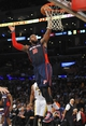 November 17, 2013; Los Angeles, CA, USA; Detroit Pistons power forward Greg Monroe (10) scores a basket against the Los Angeles Lakers during the first half at Staples Center. Mandatory Credit: Gary A. Vasquez-USA TODAY Sports