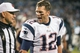 Nov 18, 2013; Charlotte, NC, USA; New England Patriots quarterback Tom Brady (12) argues with a referee while walking off the field at Bank of America Stadium. The Panthers defeated the Patriots 24-20. Mandatory Credit: Jeremy Brevard-USA TODAY Sports