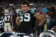 Nov 18, 2013; Charlotte, NC, USA;  Carolina Panthers middle linebacker Luke Kuechly (59) talks with teammates on the sidelines during the third quarter against the New England Patriotsat Bank of America Stadium. The Panthers defeated the Patriots 24-20. Mandatory Credit: Jeremy Brevard-USA TODAY Sports