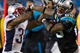 Nov 18, 2013; Charlotte, NC, USA; Carolina Panthers wide receiver Steve Smith (89) gets shoved out of bounds by New England Patriots cornerback Aqib Talib (31) during the fourth quarter at Bank of America Stadium. The Panthers defeated the Patriots 24-20. Mandatory Credit: Jeremy Brevard-USA TODAY Sports