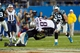 Nov 18, 2013; Charlotte, NC, USA; Carolina Panthers strong safety Robert Lester (38) tackles New England Patriots tight end Rob Gronkowski (87) during the fourth quarter at Bank of America Stadium. The Panthers defeated the Patriots 24-20. Mandatory Credit: Jeremy Brevard-USA TODAY Sports