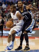 Nov 18, 2013; Los Angeles, CA, USA; Los Angeles Clippers point guard Chris Paul (3) drives the lane on Memphis Grizzlies point guard Mike Conley (11) during the sec on half at Staples Center. Mandatory Credit: Robert Hanashiro-USA TODAY Sports