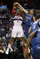 Nov 19, 2013; Washington, DC, USA; Minnesota Timberwolves point guard Alexey Shved (1) blocks the shot of Washington Wizards shooting guard Bradley Beal (3) in the second quarter at Verizon Center. Mandatory Credit: Geoff Burke-USA TODAY Sports
