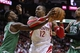 Nov 19, 2013; Houston, TX, USA; Houston Rockets power forward Dwight Howard (12) controls the ball during the second quarter as Boston Celtics shooting guard Jeff Green (8) defends at Toyota Center. Mandatory Credit: Troy Taormina-USA TODAY Sports
