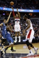 Nov 19, 2013; Washington, DC, USA; Washington Wizards shooting guard Bradley Beal (3) shoots the ball over Minnesota Timberwolves point guard Alexey Shved (1) in the second quarter at Verizon Center. The Wizards won 104-100. Mandatory Credit: Geoff Burke-USA TODAY Sports