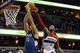Nov 19, 2013; Washington, DC, USA; Washington Wizards point guard John Wall (2) blocks an attempted dunk of Minnesota Timberwolves center Nikola Pekovic (14) in the fourth quarter at Verizon Center. The Wizards won 104-100. Mandatory Credit: Geoff Burke-USA TODAY Sports