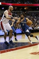 Nov 19, 2013; Washington, DC, USA; Minnesota Timberwolves point guard Ricky Rubio (9) dribbles the ball against Washington Wizards center Marcin Gortat (4) in the third quarter at Verizon Center. The Wizards won 104-100. Mandatory Credit: Geoff Burke-USA TODAY Sports