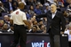 Nov 19, 2013; Washington, DC, USA; Minnesota Timberwolves head coach Rick Adelman argues a call with referee Tom Washington (49) against the Washington Wizards in the third quarter at Verizon Center. The Wizards won 104-100. Mandatory Credit: Geoff Burke-USA TODAY Sports
