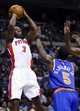 Nov 19, 2013; Auburn Hills, MI, USA; Detroit Pistons shooting guard Rodney Stuckey (3) shoots over New York Knicks shooting guard Tim Hardaway Jr. (5) in the third quarter at The Palace of Auburn Hills. Detroit 92-86. Mandatory Credit: Rick Osentoski-USA TODAY Sports