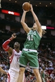 Nov 19, 2013; Houston, TX, USA; Boston Celtics center Kelly Olynyk (41) shoots during the third quarter as Houston Rockets power forward Dwight Howard (12) defends at Toyota Center. Mandatory Credit: Troy Taormina-USA TODAY Sports