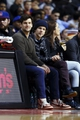 Nov 19, 2013; Auburn Hills, MI, USA; Film actors Justin Bartha (left) and Jesse Eisenberg (right) watch the game between the Detroit Pistons and the New York Knicks at The Palace of Auburn Hills. Mandatory Credit: Rick Osentoski-USA TODAY Sports