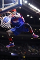 Nov 19, 2013; Auburn Hills, MI, USA; Detroit Pistons Flight Crew member performs during a time out in the second half against the New York Knicks at The Palace of Auburn Hills. Mandatory Credit: Rick Osentoski-USA TODAY Sports