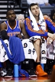 Nov 19, 2013; Auburn Hills, MI, USA; New York Knicks shooting guard Tim Hardaway Jr. (left) and power forward Andrea Bargnani (right) watch from the bench in the fourth quarter against the Detroit Pistons at The Palace of Auburn Hills. Mandatory Credit: Rick Osentoski-USA TODAY Sports