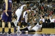 Nov 19, 2013; Sacramento, CA, USA; Sacramento Kings shooting guard Ben McLemore (16) and point guard Isaiah Thomas (22) help up center DeMarcus Cousins (15) after a play against the Phoenix Suns during the fourth quarter at Sleep Train Arena. The Sacramento Kings defeated the Phoenix Suns 107-104. Mandatory Credit: Kelley L Cox-USA TODAY Sports