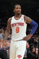 Nov 20, 2013; New York, NY, USA; New York Knicks shooting guard J.R. Smith (8) reacts during the fourth quarter of a game against the Indiana Pacers at Madison Square Garden. The Pacers defeated the Knicks 103-96 in overtime. Mandatory Credit: Brad Penner-USA TODAY Sports