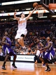 Nov 20, 2013; Phoenix, AZ, USA; Phoenix Suns guard Goran Dragic (1) lays up the ball against the Sacramento Kings defense in the second half at US Airways Center. The Kings defeated the Suns 113-106. Mandatory Credit: Jennifer Stewart-USA TODAY Sports