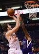 Nov 20, 2013; Phoenix, AZ, USA; Phoenix Suns guard Goran Dragic (1) puts up a shot against the Sacramento Kings guard Isaiah Thomas (22) in the second half at US Airways Center. The Kings defeated the Suns 113-106. Mandatory Credit: Jennifer Stewart-USA TODAY Sports