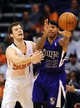 Nov 20, 2013; Phoenix, AZ, USA; Sacramento Kings guard Isaiah Thomas (22) handles the ball against the Phoenix Suns guard Goran Dragic (1) in the second half at US Airways Center. The Kings defeated the Suns 113-106. Mandatory Credit: Jennifer Stewart-USA TODAY Sports