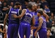 Nov 20, 2013; Phoenix, AZ, USA; Sacramento Kings guard Isaiah Thomas (22) talks with teammates forward Luc Mbah a Moute (33), center DeMarcus Cousins (15), and forward Travis Outlaw (25) in the second half against the Phoenix Suns at US Airways Center. The Kings defeated the Suns 113-106. Mandatory Credit: Jennifer Stewart-USA TODAY Sports