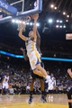 November 20, 2013; Oakland, CA, USA; Golden State Warriors shooting guard Klay Thompson (11) shoots the ball against the Memphis Grizzlies during the fourth quarter at Oracle Arena. The Grizzlies defeated the Warriors 88-81 in overtime. Mandatory Credit: Kyle Terada-USA TODAY Sports