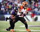 Nov 10, 2013; Baltimore, MD, USA; Cincinnati Bengals running back Giovani Bernard (25) gets tackled by Baltimore Ravens safety James Ihedigbo (32) at M&T Bank Stadium. Mandatory Credit: Evan Habeeb-USA TODAY Sports