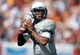 Sep 21, 2013; Los Angeles, CA, USA; Utah State Aggies quarterback Chuckie Keeton (16) throws a pass against the Southern California Trojans at the Los Angeles Memorial Coliseum. Mandatory Credit: Kirby Lee-USA TODAY Sports