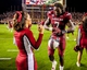 Nov 16, 2013; Columbia, SC, USA; South Carolina Gamecocks defensive end Jadeveon Clowney (7) gives his gloves to a cheerleader celebrate following their 19-14 win over the Florida Gators at Williams-Brice Stadium. Mandatory Credit: Jeff Blake-USA TODAY Sports