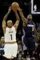 Nov 15, 2013; Cleveland, OH, USA; Cleveland Cavaliers point guard Jarrett Jack (1) shoots as Charlotte Bobcats point guard Kemba Walker (15) defends at Quicken Loans Arena. Mandatory Credit: Ken Blaze-USA TODAY Sports