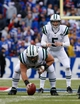 Nov 17, 2013; Orchard Park, NY, USA; New York Jets quarterback Matt Simms (5) under center Nick Mangold (74) during the second half against the Buffalo Bills at Ralph Wilson Stadium. Bills beat the Jets 37-14. Mandatory Credit: Kevin Hoffman-USA TODAY Sports