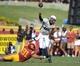 Sep 21, 2013; Los Angeles, CA, USA; Utah State Aggies quarterback Chuckie Keeton (16) is pressured by Southern California Trojans linebacker Morgan Breslin (91) at the Los Angeles Memorial Coliseum. USC defeated Utah State 17-14. Mandatory Credit: Kirby Lee-USA TODAY Sports