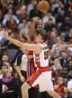 Nov 22, 2013; Toronto, Ontario, CAN; Toronto Raptors forward Tyler Hansbrough (50) guards against Washington Wizards forward Nene (42) as he passes the ball at Air Canada Centre. The Raptors beat the Wizards 96-88. Mandatory Credit: Tom Szczerbowski-USA TODAY Sports