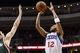 Nov 22, 2013; Philadelphia, PA, USA; Philadelphia 76ers guard Evan Turner (12) shoots a jump shot during overtime against the Milwaukee Bucks at Wells Fargo Center. The Sixers defeated the Bucks 115-107 in overtime. Mandatory Credit: Howard Smith-USA TODAY Sports