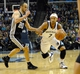 Nov 22, 2013; Memphis, TN, USA; Memphis Grizzlies point guard Jerryd Bayless (7) drives to the basket against San Antonio Spurs shooting guard Manu Ginobili (20) during the third quarter at FedExForum. Mandatory Credit: Justin Ford-USA TODAY Sports