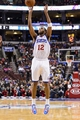 Nov 22, 2013; Philadelphia, PA, USA; Philadelphia 76ers guard Evan Turner (12) shoots a jump shot during the fourth quarter against the Milwaukee Bucks at Wells Fargo Center. The Sixers defeated the Bucks 115-107 in overtime. Mandatory Credit: Howard Smith-USA TODAY Sports