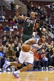 Nov 22, 2013; Philadelphia, PA, USA; Philadelphia 76ers guard Evan Turner (12) gets Milwaukee Bucks forward Caron Butler (3) off his feet during the fourth quarter at Wells Fargo Center. The Sixers defeated the Bucks 115-107 in overtime. Mandatory Credit: Howard Smith-USA TODAY Sports