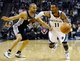 Nov 22, 2013; Memphis, TN, USA; Memphis Grizzlies point guard Mike Conley (11) drives to the basket against San Antonio Spurs point guard Tony Parker (9) during the fourth quarter at FedExForum. San Antonio Spurs beat the Memphis Grizzlies 102-86. Mandatory Credit: Justin Ford-USA TODAY Sports