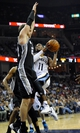 Nov 22, 2013; Memphis, TN, USA; Memphis Grizzlies point guard Mike Conley (11) lays the ball up against San Antonio Spurs center Tiago Splitter (22) during the fourth quarter at FedExForum. San Antonio Spurs beat the Memphis Grizzlies 102-86. Mandatory Credit: Justin Ford-USA TODAY Sports