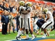 Nov 23, 2013; Syracuse, NY, USA; Pittsburgh Panthers tight end Manasseh Garner (82) celebrates his second quarter touchdown with running back Isaac Bennett (34) against the Syracuse Orange during the second quarter at the Carrier Dome.  Mandatory Credit: Rich Barnes-USA TODAY Sports