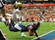 Nov 23, 2013; Syracuse, NY, USA; Syracuse Orange wide receiver Alvin Cornelius (82) dives for the end zone for a touchdown in front of Pittsburgh Panthers defensive back Lafayette Pitts (23) during the third quarter at the Carrier Dome.  Mandatory Credit: Rich Barnes-USA TODAY Sports