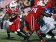 Nov 23, 2013; Louisville, KY, USA; Louisville Cardinals running back Senorise Perry (32) runs the ball against the Memphis Tigers during the second half at Papa Johns Cardinal Stadium. Louisville defeated Memphis 24-17.  Mandatory Credit: Jamie Rhodes-USA TODAY Sports