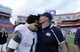 Nov 23, 2013; Gainesville, FL, USA; Georgia Southern Eagles head coach Jeff Monken kisses quarterback Jerick McKinnon (1) after they beat the Florida Gators at Ben Hill Griffin Stadium. Georgia Southern Eagles defeated the Florida Gators 26-20. Mandatory Credit: Kim Klement-USA TODAY Sports