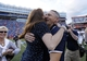 Nov 23, 2013; Gainesville, FL, USA; Georgia Southern Eagles head coach Jeff Monken hugs his wife Beth Monken after they beat the Florida Gators at Ben Hill Griffin Stadium. Georgia Southern Eagles defeated the Florida Gators 26-20. Mandatory Credit: Kim Klement-USA TODAY Sports
