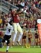 Nov 23, 2013; Tallahassee, FL, USA; Florida State Seminoles wide receiver Kelvin Benjamin (1) catches a touchdown over Idaho Vandals cornerback Jayshawn Jordan (4) during the second half at Doak Campbell Stadium. Mandatory Credit: Melina Vastola-USA TODAY Sports