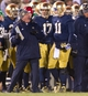 Nov 23, 2013; South Bend, IN, USA; Notre Dame Fighting Irish head coach Brian Kelly talks with quarterback Tommy Rees (11) in the fourth quarter against the BYU Cougars at Notre Dame Stadium. Notre Dame won 23-13. Mandatory Credit: Matt Cashore-USA TODAY Sports