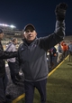 Nov 23, 2013; Denton, TX, USA; UTSA Roadrunners head coach Larry Coker celebrates the win over the North Texas Mean Green at Apogee Stadium. The Roadrunners defeated the Mean Green 21-13. Mandatory Credit: Jerome Miron-USA TODAY Sports