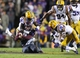 Nov 23, 2013; Baton Rouge, LA, USA; Texas A&M Aggies quarterback Johnny Manziel (2) is tackled by LSU Tigers linebacker Lamin Barrow (18) in the second half at Tiger Stadium. LSU defeated Texas A&M 34-10. Mandatory Credit: Crystal LoGiudice-USA TODAY Sports