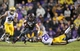 Nov 23, 2013; Baton Rouge, LA, USA; LSU Tigers cornerback Jalen Mills (28) reaches out to tackle Texas A&M Aggies wide receiver Travis Labhart (15) in the second half at Tiger Stadium. LSU defeated Texas A&M 34-10. Mandatory Credit: Crystal LoGiudice-USA TODAY Sports