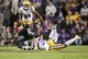 Nov 23, 2013; Baton Rouge, LA, USA; Texas A&M Aggies wide receiver Travis Labhart (15) is tripped up by LSU Tigers cornerback Jalen Mills (28) in the second half at Tiger Stadium. LSU defeated Texas A&M 34-10. Mandatory Credit: Crystal LoGiudice-USA TODAY Sports
